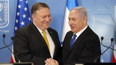 US Secretary of State Mike Pompeo. left. is greeted by Israeli Prime Minister Benjamin Netanyahu  in Tel Aviv, on Sunday.
