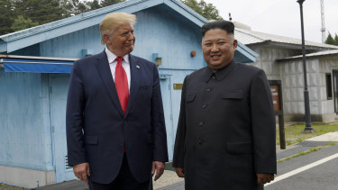 President Donald Trump, left, meets with North Korean leader Kim Jong-un at the border village of Panmunjom in the Demilitarised Zone.