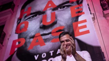 Spain's Prime Minister and Socialist Party leader Pedro Sanchez winks to supporters outside the party headquarters following the general election in Madrid, Spain.