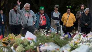 A Maori elder leads a prayer in language at a makeshift shrine of flowers near the Al Noor Mosque.
