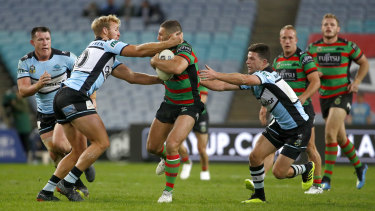 Strong carry: Robbie Farah of the Rabbitohs is tackled in his first NRL appearance this season.