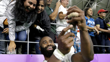 Semi Radradra takes a selfie for fans in Oita after the loss to Wales in the Rugby World Cup.