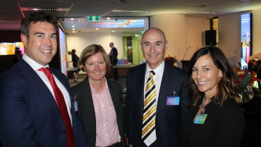 Brendon Riley (middle right) at the launch of the Telstra customer insight centre in Perth on Monday.