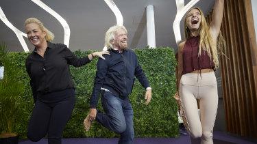 Sir Richard Branson and Sunrise's Samantha Armytage learning yoga from Sjana Elise Earp at the Virgin Lounge at Sydney Airport on Thursday.