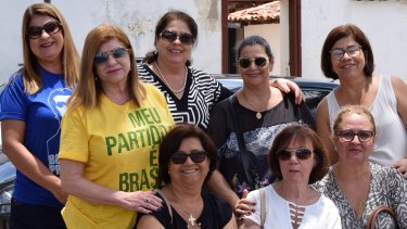 Backing Bolsonaro: Lourdes (yellow T-shirt), Fatima (second from left, back row) and Clea (left, front row).