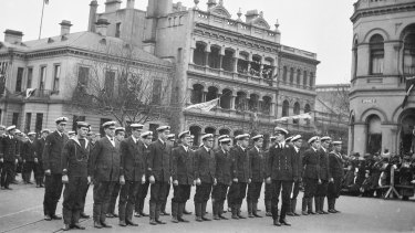 Sailors stand at attention in Spring Street.