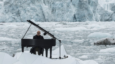 Italian composer and pianist Ludovico Einaudi performs  on a floating platform in the Arctic Ocean