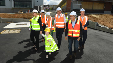 Daniel Andrews (centre)  Deputy Premier James Merlino (second from right) tour the new Pakenham Primary School on Wednesday.