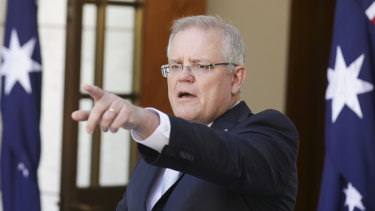 Prime Minister Scott Morrison announcing new measures to stem damage from the coronavirus crisis at Parliament House in Canberra on  Sunday.