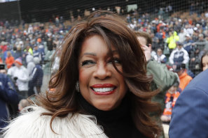 Mary Wilson is escorted after singing the national anthem before a baseball game between the Detroit Tigers and the Kansas City Royals in Detroit in 2019.