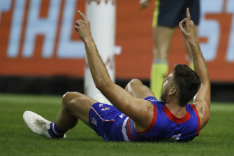 Marcus Bontempelli celebrates after booting a goal in the Bulldogs' win over Melbourne.