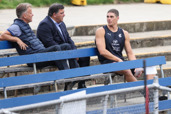Charlie Curnow watches on from the stands during a Carlton training session at Princes Park last Friday.