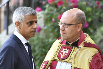 Southwark Cathedral Dean Andrew Nunn speaks with mayor of London Sadiq Khan for a memorial to mark one year since the deadly 2017 London Bridge and Borough Market attack.