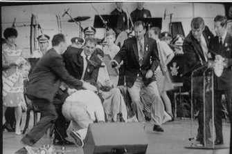 From left, a policeman, then-NSW premier John Fahey and Ian Kiernan rush to subdue an attacker as Prince Charles, right, is ushered away by a security man during an event at Darling Harbour in January 1994.