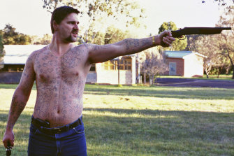 """Bana as the """"""""very intriguing, complicated, sometimes humorous"""" Mark """"Chopper"""" Read."""