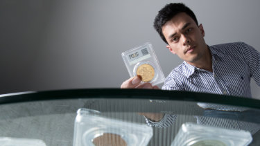 Eric Eigner, founder of Drake Sterling Numismatics, with some of the collectable coins he sells.