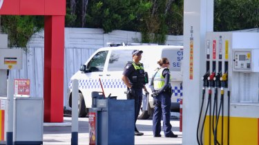 Police at the Coles Express service station on Melton Highway near Taylors Lakes on Saturday morning.