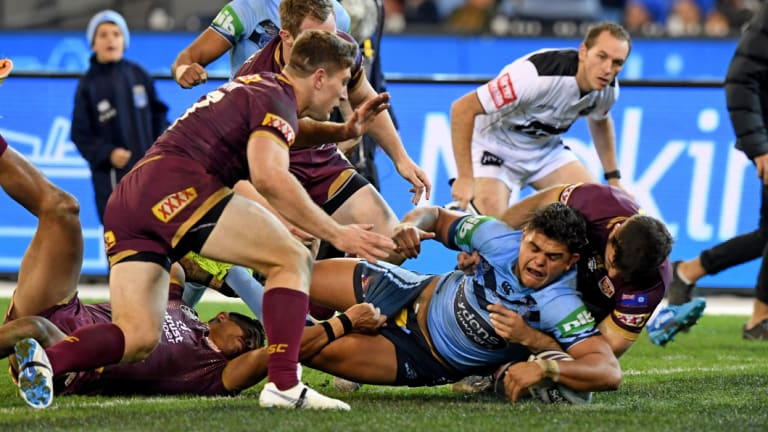 Try time: Latrell Mitchell goes over in the second half.