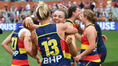 Erin Phillips and Ebony Marinoff celebrate after the siren.