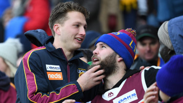 'It's going to be a massive game': Alex Witherden (left, with a fan) and the Lions are expecting a near sell-out at the Gabba on Saturday.