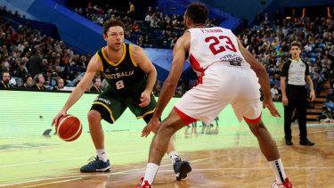 Matthew Dellavedova of the Boomers comes up against Phil Scrubb of Canada on Friday night.