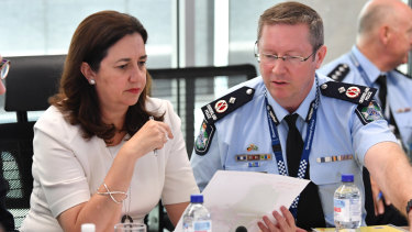Queensland Premier Annastacia Palaszczuk (left) with Emergency Services deputy commissioner Bob Gee (right) .
