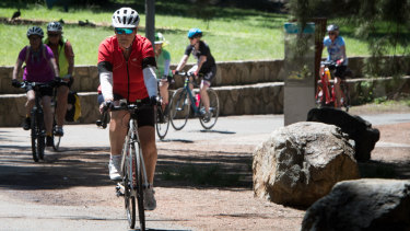 Sue Lake and fellow pedal power cyclists return from a morning ride at Lake Ginninderra to avoid the hottest part of the day.