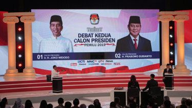 Indonesian President Joko Widodo, left, gestures towards his opponent, Prabowo Subianto, during a second presidential debate in Jakarta on Sunday.