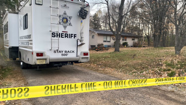 A sheriff's vehicle outside the home where James and Denise Closs were found dead.