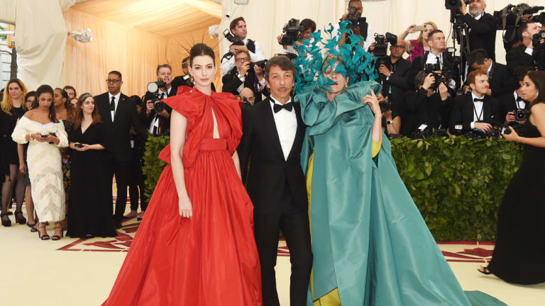 """Piccioli at May's Met Gala with actors Anne Hathaway (left) and Frances McDormand, who says of her Valentino gown, """"It's the most fun I've ever had in an article of clothing."""""""