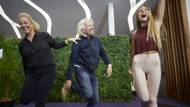 Sir Richard Branson and Sunrise's Samantha Armytage learning yoga from Sjana Elise Earp at the Virgin Lounge at Sydney Airport on Thursday.