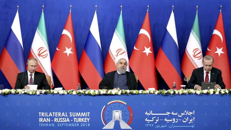 From left: Russian President Vladimir Putin, Iran's Hassan Rouhani and Turkey's Recep Tayyip Erdogan after they failed to agree on a diplomatic solution  in Tehran, Iran, on Friday.