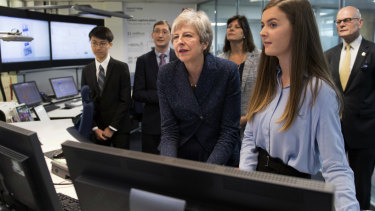 Theresa May observing machinery which converts carbon dioxide into oxygen on the day she announced plans to eliminate the UK's net emissions.