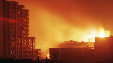 A huge fire rages through central Pristina after a NATO missile strike in April 1999.