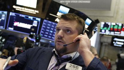 Wall Street approaches records as Fed soothes market's fears