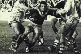 Eastern Suburbs second-rower Barry Reilly struggles to break the gasps of St. George defenders including Barry Beath (left) and Rod Reddy (No.10) Kevin Stevens and Jim Porter are in support in 1974.