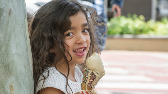 Sisters Harlow and Zahlia Lutfi (6) and little sister Harlow (3) cool off by eating an icecream cone on a sweltering Canberra day.