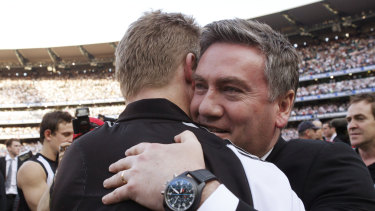 Eddie McGuire embraces then assistant coach Nathan Buckley after Collingwood win the 2010 flag.