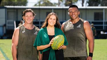 Wallabies captain Michael Hooper and prop Allan Alaalatoa with Indigenous schoolgirl Olivia Fox.