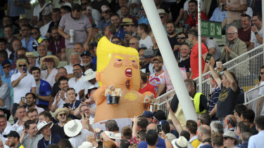 Full of hot air: A fan wears a Donald Trump inflatable, during day three of the first Ashes Test.