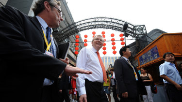 Former colleagues: then ambassador Geoff Raby (left) takes then prime minister Kevin Rudd (centre) on a tour of central Beijing in 2008.