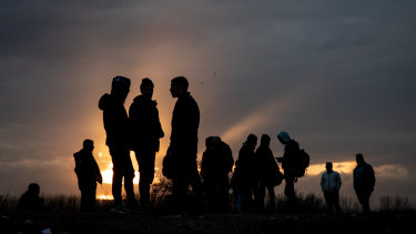 Refugees and migrants are seen at a makeshift camp next to the Edirne Old Bridge in Turkey. Thousands of refugees and migrants have flocked to the border after Turkey made good on a promise to stop blocking their passage to Europe.