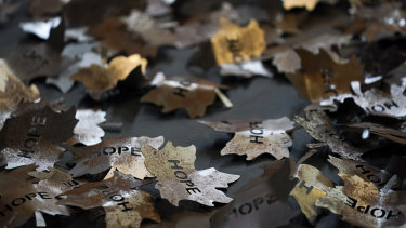 Some of The Leaves of the Trees art installation by the artist Peter Walker, a carpet of 5000 steel leaves laid out on the floor as a memorial honouring those who lost their lives due to the coronavirus pandemic, at Worcester Cathedral in England.