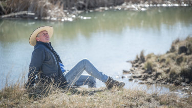Braidwood farmer Martin Royds beside his new dam, dug two weeks ago, which immediately started to fill up with groundwater.