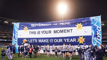 Time to shine: Geelong players walk to the banner before taking on Collingwood in the first qualifying final.
