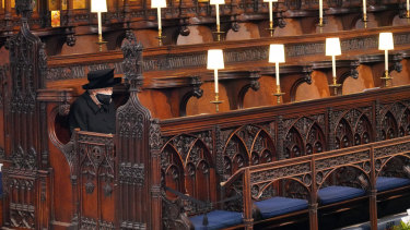 The Queen takes her seat ahead of the funeral service for Prince Philip.