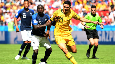 Canberra export Tom Rogic working hard in the Socceroos World Cup opener against France.