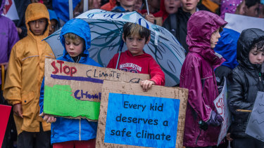 Canberra students braved the rain to protest outside Parliament House during last November's school climate strike.