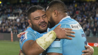 Pure joy: Tolu Latu, left, and Sekope Kepu embrace after the Waratahs booked a place in the Super Rugby semi-finals.