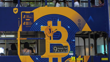 A global phenomenon. An advertisement for Bitcoin on a tram in Hong Kong.